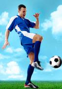 Portrait of soccer player hitting the ball Stock Photos