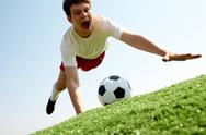 Image of soccer player falling down and shouting Stock Photos