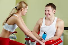 portrait of sporty couple interacting during break - stock photo