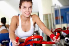 Portrait of young female training in gym Stock Photos