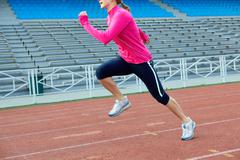 A girl running in the stadium Stock Photos