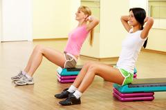 Stock Photo of image of two young women practicing physical exercises