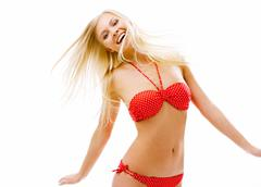 Image of happy woman in red bikini looking at camera Stock Photos