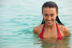 portrait of wet attractive woman in water - stock photo