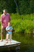 Photo of grandfather and grandson on pontoon fishing on weekend Stock Photos