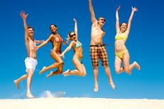 Photo of slim energetic people jumping and screaming at summer Stock Photos