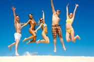 Stock Photo of photo of slim energetic people jumping and screaming at summer