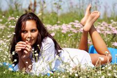 Portrait of young woman lying on the grass Stock Photos