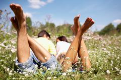 close-up of legs of lying pair - stock photo