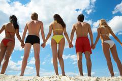 Rear view of people holding by hands at summer Stock Photos
