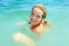 photo of pretty young woman swimming in the lake - stock photo