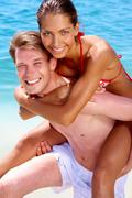 Portrait of joyful couple having fun in the water Stock Photos