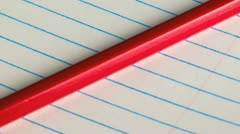Pencil on a lined pad of paper Stock Footage