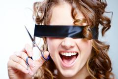 Stock Photo of portrait of woman shouting and with cutting black bandage on eyes