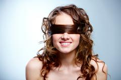 portrait of nude woman with curls covering eyes - stock photo