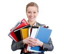 Portrait of happy businesswoman with colorful folders smiling at camera Stock Photos