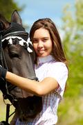 image of happy female with purebred horse near by - stock photo