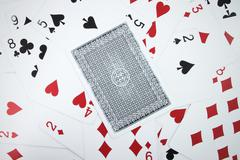 Card with playing cards background Stock Photos