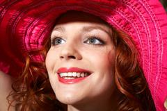 part of face of young female with ginger hair looking aside - stock photo