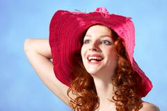 Part of happy young female with ginger hair looking aside and laughing Stock Photos