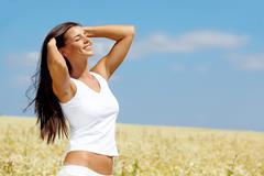 image of happy female enjoying life on summer day - stock photo