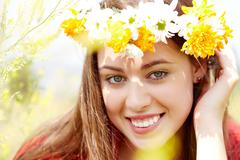 Image of happy female wearing wildflower wreath on summer day Stock Photos