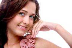 Portrait of charming woman looking at camera with smile Stock Photos