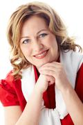Portrait of middle-aged blond female looking at camera with smile Stock Photos