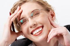 image of happy woman in eyeglasses touching her face and laughing - stock photo