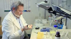 Biochemist  working  in a laboratory Stock Footage