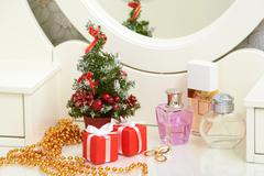 Christmas composition on lady toiletries table Stock Photos