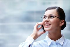 photo of smart businesswoman calling somebody and smiling - stock photo