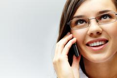 photo of smart businesswoman calling somebody in isolation - stock photo