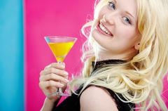 Portrait of stylish woman with martini looking at camera Stock Photos