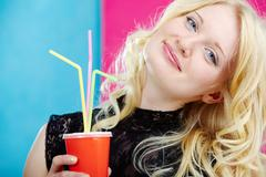 Stock Photo of portrait of stylish woman with soda looking at camera