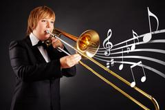 Stock Photo of portrait of young female playing the trombone