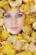 Close-up of face of serious woman in natural foliage Stock Photos