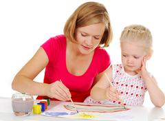 photo of cute preschooler and her mother painting with aquarelle - stock photo