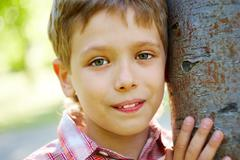 Portrait of handsome schoolboy smiling at camera Stock Photos