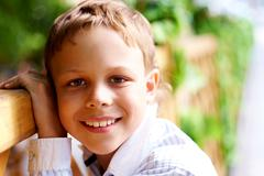 portrait of happy kid looking at camera - stock photo