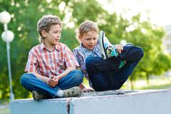 Portrait of two calm kids spending time together outdoors Stock Photos
