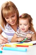 photo of cute preschooler and her mother drawing - stock photo