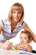 photo of cute preschooler and her mother drawing together - stock photo
