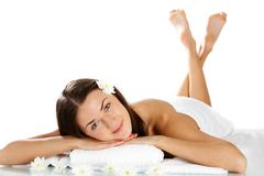 Beautiful girl lying on towels and looking at camera Stock Photos