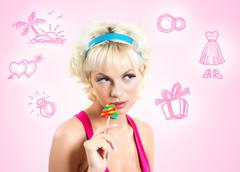 Blonde with lollipop - stock photo