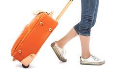photo of elegant female carrying red suitcase - stock photo