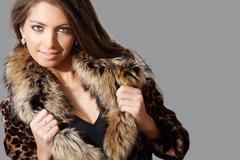 portrait of sexy female in fashionable coat posing during photoshoot - stock photo