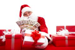 Photo of happy santa claus selling christmas gifts and looking at camera Stock Photos