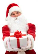 santa claus giving small decorated box - stock photo