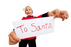 happy lad holding letter with note 'to santa' in isolation - stock photo